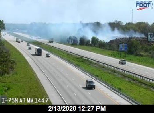 A fire in a pile of logs and wood at MW Horticultural Recycling in North Fort Myers continued to burn Thursday. Officials   ordered the business owners to let the fire burn itself out. A Florida Highway Patrol alert cautioned drivers on Interstate 75 on possible visibility issues from smoke.