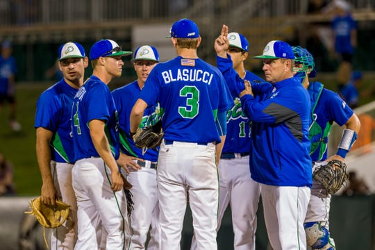 FGCU coach Dave Tollett makes a pitching change during a game against the University of Miami in 2016.