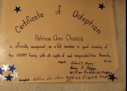 An unofficial adoption paper from 1972 showing Patricia was a member of the Happy family in Burlington, Vermont, was signed by the whole family.