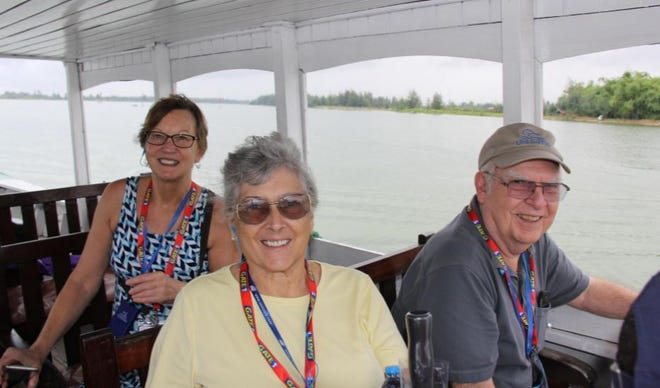 Patricia Happy, background,  Diane, left, and Richard during a family vacation to Vietnam. The couple took Diane in as a foster child in 1971 and adopter her nearly 50 years later.