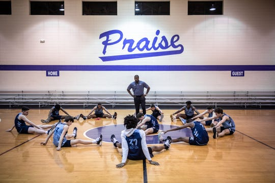 The Greer Middle College basketball team stretches before practice at Praise Cathedral Monday, February 10, 2020.