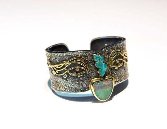 A bracelet by Llyn Strong.