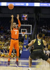 Clemson guard Al-Amir Dawes (2) shoots a 3-point basket against Pittsburgh during the first half of Wedneday's game.
