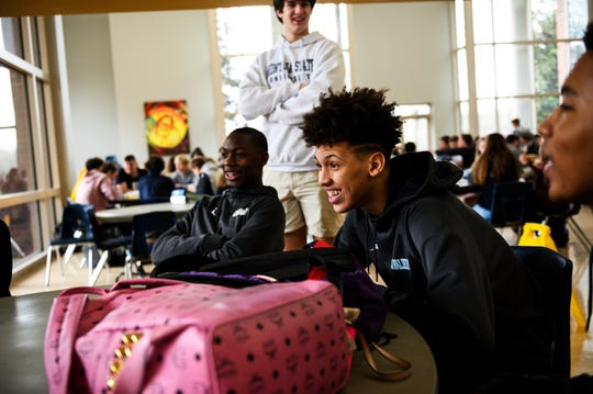 Jordan Butler, middle, during lunch with his friends at Christ Church Episcopal School Wednesday, Feb. 14, 2020.