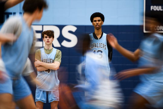 John Butler Jr. watches his teammates practice at Christ Church Episcopal School Wednesday, Feb. 13, 2020.