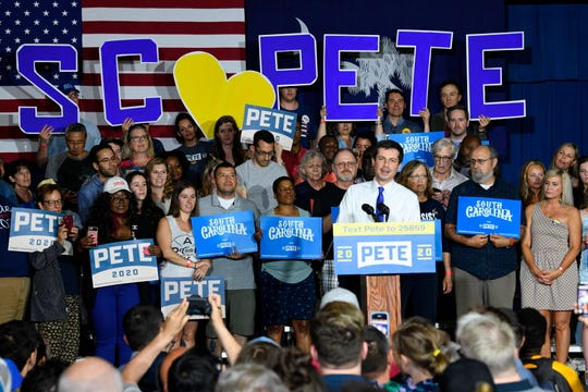 FILE - In this May 5, 2019 file photo, Democratic presidential contender Pete Buttigieg holds a town hall in North Charleston, South Carolina. Democratic presidential contender Pete Buttigieg is picking up his first endorsement among South Carolina's black lawmakers as attention in the early voting contest turns toward more diverse states. Buttigieg's campaign announced Wednesday that the former South Bend, Indiana, mayor would be receiving backing from state Rep. JA Moore, a Democrat from Charleston. (AP Photo/Meg Kinnard)