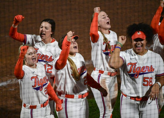 Clemson players sing the alma mater after a 10-0 no-hitter win over Western Carolina at Clemson Softball Stadium in Clemson February 12, 2020.