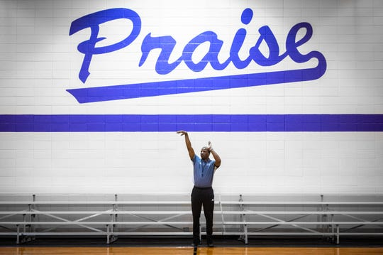 Greer Middle College basketball coach Jamar Armstrong talks to one of his players during practice at Praise Cathedral Monday, February 10, 2020.