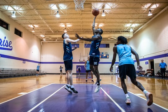 Greer Middle College's Allen Kuria jumps up for a shot while defended by teammate Anderson Kirkland during practice at Praise Cathedral Monday, February 10, 2020.