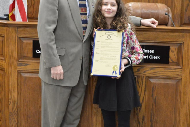 Fifth-grader Alexis Francke was named the February Judge's Scholar for Jefferson Elementary.  Her parents are Jill Brady and Kevin Francke. She is posing here with Henderson County Judge-executive Brad Schneider.