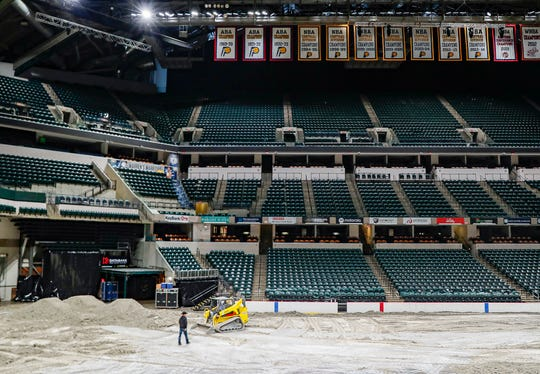 Excavators flatten out lime and dirty Bankers Life Fieldhouse, Indianapolis, Thursday, Feb. 13, 2020. The Fieldhouse goes under a transformation preparing for CINCH World's Toughest Rodeo by pulling up the basketball court, laying down dirt and cattle shoots.