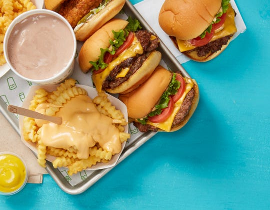 Classic double cheeseburgers and crinkle-cut fries covered in a cheddar and American cheese sauce blend are what made Shake Shack one of the most popular burger restaurants in the United States.
