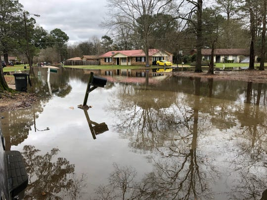 Flood waters have already seeped into northeast Jackson, threatening homes at the intersection of Deer Trail and River Road on Thursday, Feb. 13, 2020.