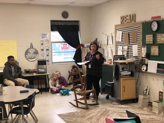 Haywood Elementary teacher Pamla Reagan discusses a text with her students. Haywood County has adopted a rigorous English curriculum that engages students through discussion.