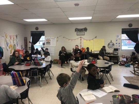 Haywood Elementary students answer open-ended questions during a class discussion. The new English curriculum encourages student engagement and enhanced reading and writing.