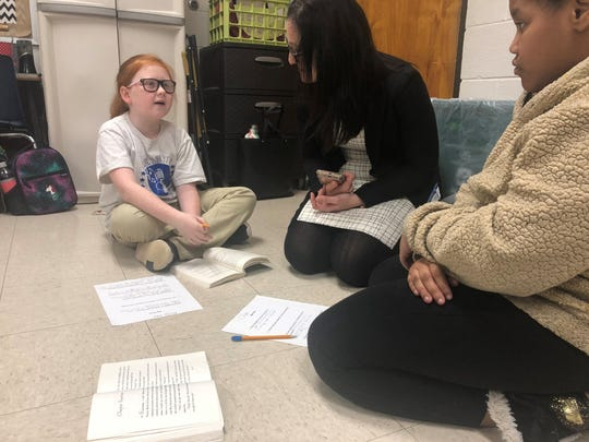 Haywood Elementary students Bailey Anne Poole and Chloe Williamson answer open-ended questions after reading a text as Lisa Coons, TDOE Chief of Standards and Materials, discusses the text with them. TDOE representatives visited the school as part of a national campaign about English curriculum.