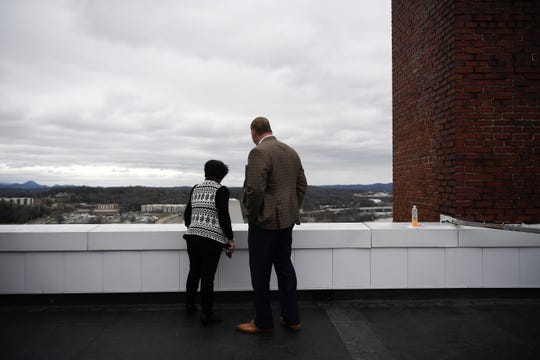 Knox County Mayor Glenn Jacobs stands with county commissioner Michele Carringer on the roof of the Andrew Johnson Building, which is located at 912 South Gay Street, is seen during a tour for county commissioners and the media, Thursday, Feb. 13, 2020. Knox County is attempting to sell the building which was the home of the Knox County school system.