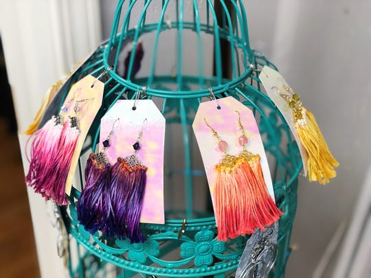 Dip-dyed tassel earrings at Folly Boutique have a similar look to the popular tie-dye trend that will be popular in spring. 2020.