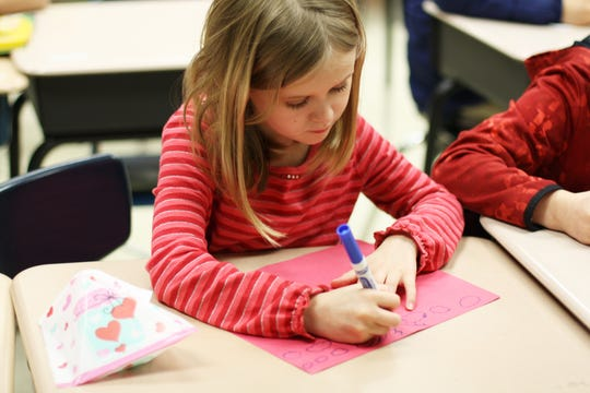 New Hopewell Elementary school student, Alyssa Walker decorates a Valentine's Day card as part of a service project on Feb. 12, 2020.