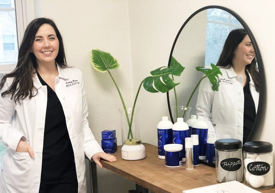 """Lindsey Horner, owner of Pharmhouse Skin & Wellness, in one of her treatment rooms at 115 Gresham Road in Fountain City. """"It's exciting; I like meeting new people,"""" she said. """"When people come see me, they are willing to put the work in with their regimens. I love what I do."""" Feb. 12, 2020."""