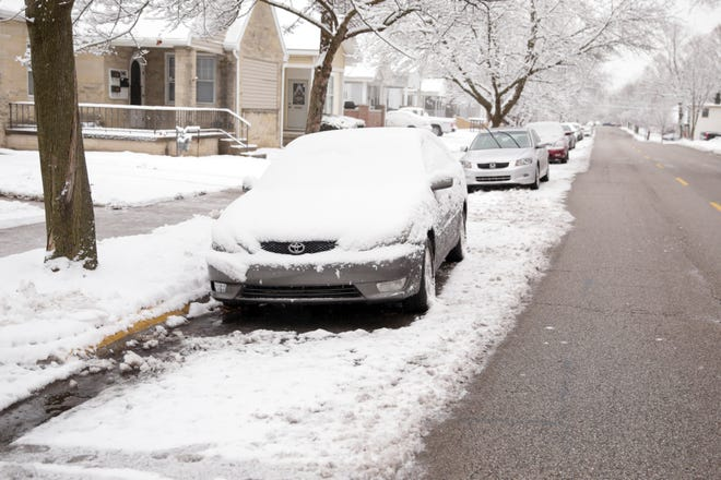 Cars sit covered in snow along N Salisbury Street, Thursday, Feb. 13, 2020 in West Lafayette.