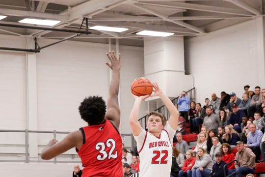 West Lafayette guard Colin Martin (22) goes up for three against Lafayette Jeff's Armoni Williams (32) during the second quarter of an IHSAA boys basketball game, Wednesday, Feb. 12, 2020 in West Lafayette.