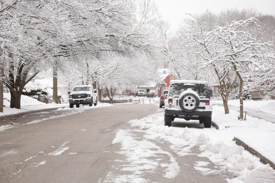 A trail of snow is left behind from a snow plow on Lawn Avenue, Thursday, Feb. 13, 2020 in West Lafayette.