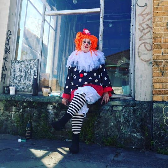 A clown sits by a window in the Bywater neighborhood Mardi Gras day, March 5, 2019.