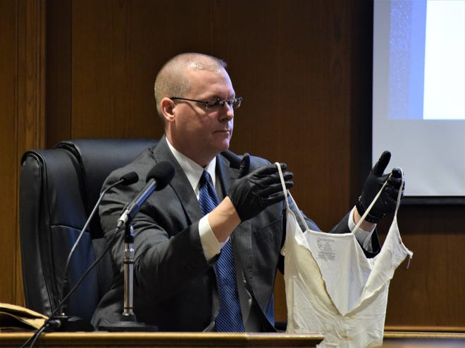 Lancaster Police Detective Kurt Humbert holds a torn tank top for the jury to see during Chad Kerens' murder trial Feb. 13. Kerens is accused of killing one man and destroying or tampering with evidence to hide that crime.