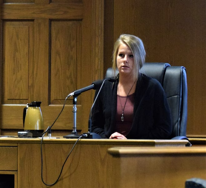 Kassaundra Phillips takes a second to compose herself as she answers questions during Chad Kerens' jury trial Feb. 12. Kerens is accused of murdering one man and attempting to destroy and tamper with evidence. Phillips testified Kerens asked her to say the victim was trying to rape her when he intervened.