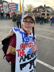 Courtney Griffieth wears a protest sign during a Jan. 7 gun-rights rally at the Kentucky statehouse.