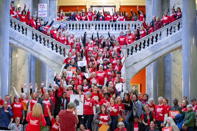 Attendees of a Moms Demand Action for Gun Sense in America rally inside the Capitol Rotunda line the stairs for a group photo on Feb. 13, 2020.