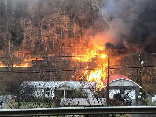 Flames rise after a train derailment on Thursday in Pike County.