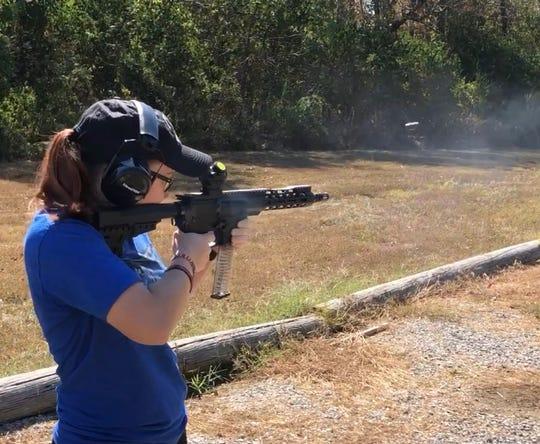 Courtney Griffieth fires a rifle at Burgin Gun Range in Burgin, Kentucky.