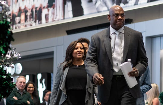 New Michigan State football coach Mel Tucker and his wife Jo-Ellyn enter Gilbert Pavilion in Michigan State's Breslin Center prior to his first presser at the helm of MSU's football program as MSU basketball coach Tom Izzo and his wife Lupe look on.
