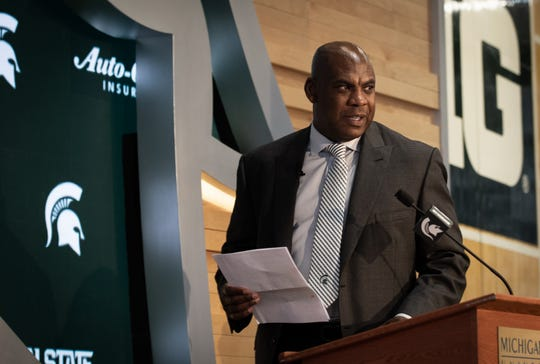 New Michigan State football coach Mel Tucker approaches the podium for his first official press conference as leader of the football program, Wednesday, Feb. 12, 2020, at the Gilbert Pavilion in Michigan State's Breslin Center.