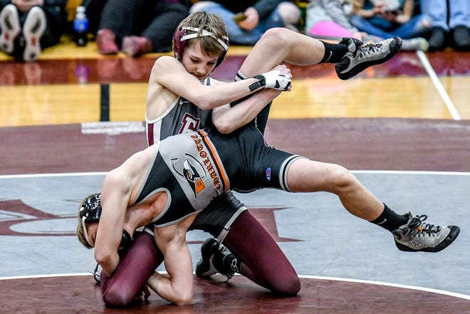 Eaton Rapid's JJ Shaull, top, wrestles with Charlotte's Jayden Schwartz during their 103-pound weight class match on Wednesday, Jan. 12, 2020, at Eaton Rapids High School. Shaull won the match.