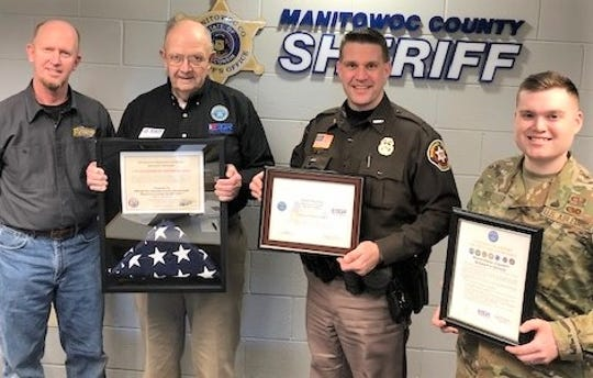 Manitowoc County Sheriff Dan Hartwig (second from right) was recognized with the Patriots Award on Feb. 10. Pictured, from left:John Brunner, Manitowoc County Board member;Command Sgt. Major Retired Clarence Brunner,an ESGR representative for the Department of Defense holding a flag that flew over anAmerican air base in Afghanistan presented by sheriff's deputy and Senior Airman Edward Wick;Hartwig, holding the Patriots Award he received; and Senior Airman Wick, holding an SOS award for the Sheriff's Office support of reserve forces.