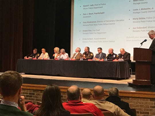 A panel of Stevens Point area school, police and health officials answer questions from attendees Wednesday during a school safety community meeting Wednesday at the Stevens Point Area High School.