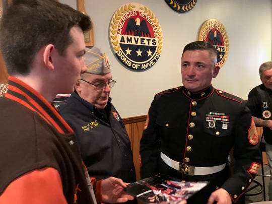 """Tim Chambers, also known as """"The Saluting Marine"""" for standing amid the motorcycle riders in Washington D.C.  on the Sunday prior to Memorial Day, talks with Nick Sayers, 17, of Mansfield, whom he met in D.C. on Veteran's Day 2019. In the center is Nick's grandfather Bob Grose."""