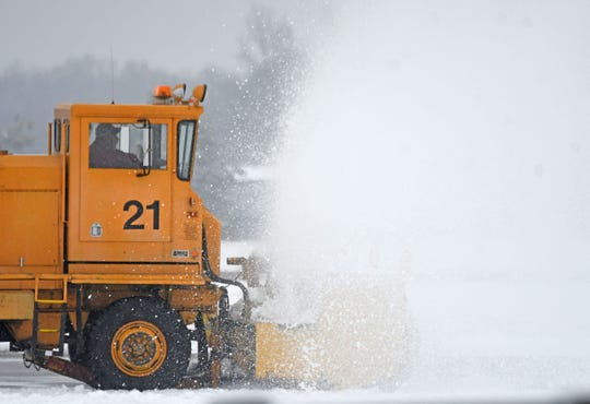 Crews worked all morning Thursday to keep the runways of Lahm Airport clear of ice and snow.
