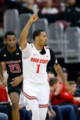 Ohio State Buckeyes guard Luther Muhammad (1) reacts after hitting a three point basket over Rutgers Scarlet Knights guard Montez Mathis (23) during the second half at Value City Arena.