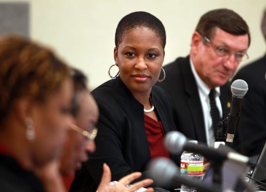 June 11, 2012 -  Tomeka Hart listens to discussion during a special meeting called by the Unified School Board.
