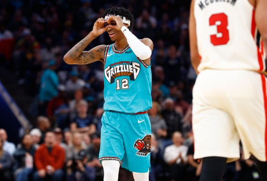 Memphis Grizzlies guard Ja Morant looks through the googles after dishing out an assist against the Portland Trail Blazers during their game at the FedExForum on Wednesday, February 12, 2020.