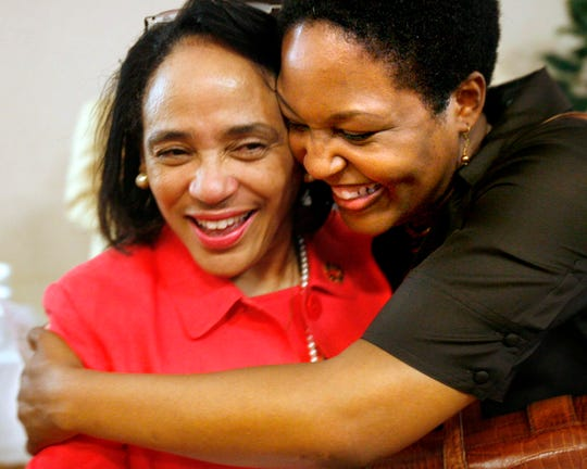 Aug. 6, 2007 - Memphis City Schools superintendent Dr. Carol Johnson gets a hug from school board commissioner Tomeka Hart at Johnson's farewell party at the Teaching and Learning Academy/Telecommunications Center auditorium.