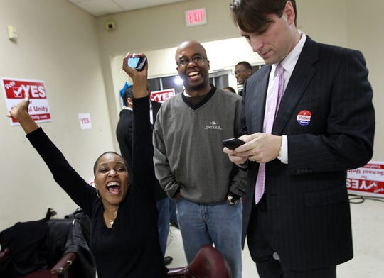 March 8, 2011 - MCS board members Tomeka Hart and Martavius Jones and Memphis City Council member Shea Flinn react as Hart announces a text message with early voting numbers at the Citizens for Better Education headquarters