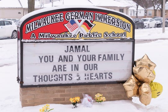 A sign outside Milwaukee German Immersion School offers condolences to the family of Jamal Anderson Jr., a 5-year-old student who died of a gunshot wound on Saturday, Feb. 8, 2020.