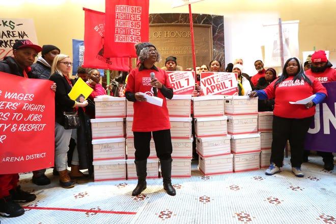 Lauren Stevens, an activist for Fight for $15, speaks at Milwaukee City Hall.