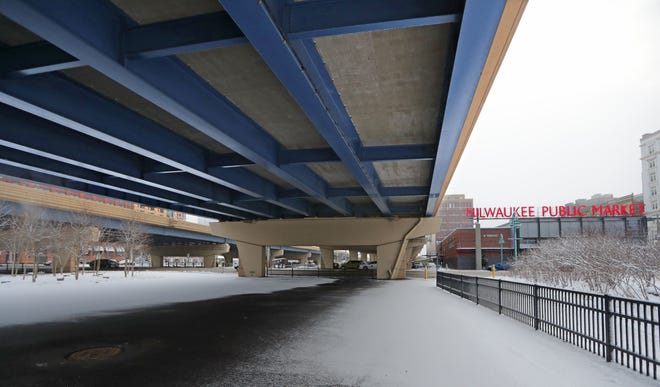 This empty space beneath I-794 between North Water Street and the Milwaukee River will host live music and other events this summer.
