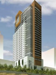 The stalled Goll House apartment tower site is being listed for sale.